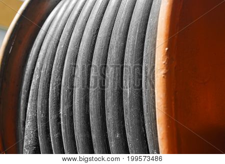 large yellow metal coil with electric cable outdoor closeup