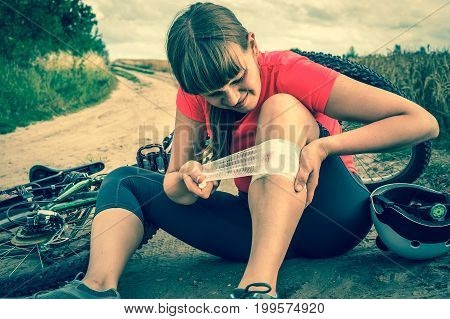 Woman With Pain In Knee After Falling Down From Bicycle