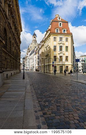 DRESDEN GERMANY - SEPTEMBER 09 2015: The streets of the old town. In the background Frauenkirche. Dresden is the capital of Saxony.