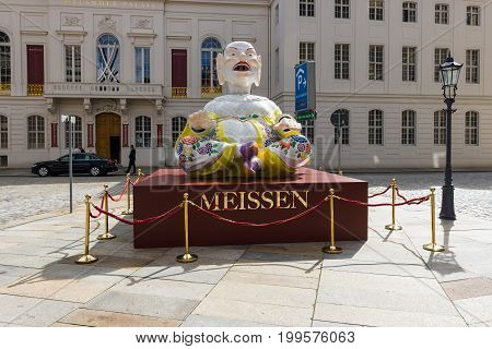 DRESDEN GERMANY - SEPTEMBER 09 2015: Chinese idol. Advertising Meissen porcelain. Meissen porcelain is the first European hard-paste porcelain that was developed from 1708 by Ehrenfried Walther von Tschirnhaus.