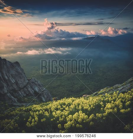 A View Of Mountain Valley With Colorful Clouds. Instagram Stylization