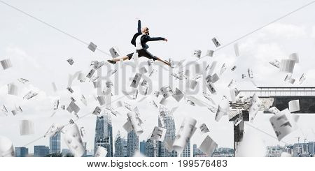 Business woman jumping over gap with flying paper documents in concrete bridge as symbol of overcoming challenges. Cityscape on background. 3D rendering.