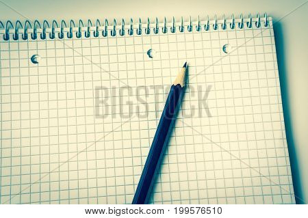 Pencil and notebook isolated on white background - retro style
