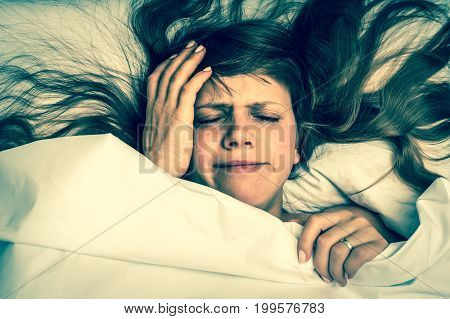 Woman In Bed Having Headache In The Morning