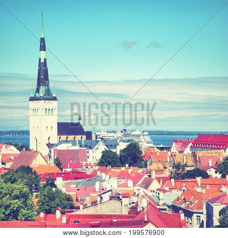Old town of Tallin with St. Olaf's Church, Estonia. Retro style filtred image