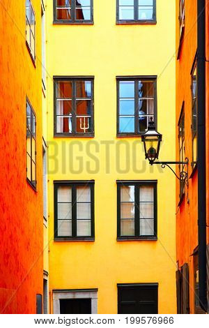 Old street with yellow houses in Stockholm, Sweden