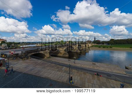 DRESDEN GERMANY - SEPTEMBER 09 2015: The oldest bridge over the Elbe - Augustus Bridge. Dresden is the capital city of the Free State of Saxony.