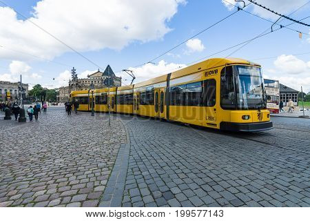 DRESDEN GERMANY - SEPTEMBER 09 2015: City Tram in the historic center. Dresden is the capital city of the Free State of Saxony.