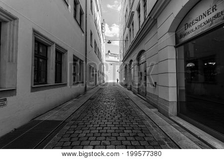 DRESDEN GERMANY - SEPTEMBER 09 2015: The old streets in the historic center. Black and white. Dresden is the capital city of the Free State of Saxony.