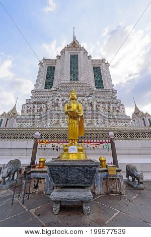 Golden Statue At White Pagoda In Wat Arun Ratchawararam Ratchawaramahawihan In Thailnd