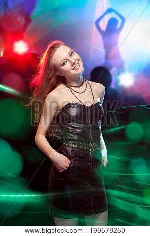 Clubber Dancing And Looking At Camera With Smile