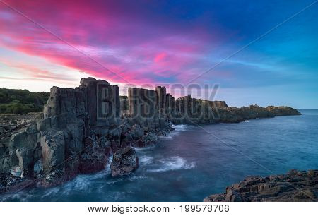 Basalt rock formations with a view to the sea at Bombo Headland quarry New South Wales Australia