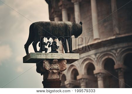 Leaning tower with Capitoline Wolf (or she-wolf) sculpture in Pisa, Italy as the worldwide known landmark.