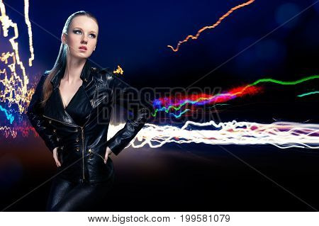 Young Beautiful Woman On Background Of Night Lights