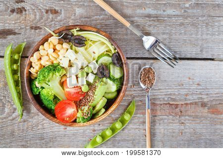 Green buddha bowl with zucchini pasta sprouts chickpeas tofu and vegetables. Love for a healthy vegan food concept.