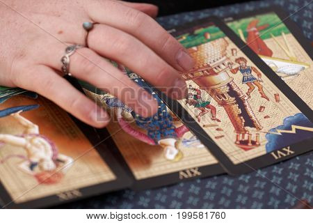 ST. PETERSBURG, RUSSIA - JULY 8, 2017: Divination using Tarot cards during the military history project Battle On Neva at St. Peter and Paul fortress. It's the 4th such an event