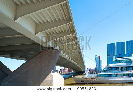 Rotterdam The Nederlands - July 18 2016: A Tour boat under the Erasmus bridge on the Maas river