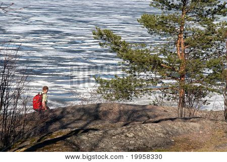 Tourist With A Backpack On A Background A Lake