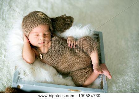 Cute Newborn Baby Sleeps With A Toys