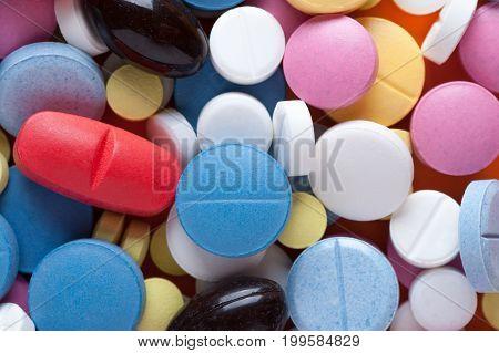 Closeup of multicolored medicine pills and capsules. Pharmaceutical medicaments.