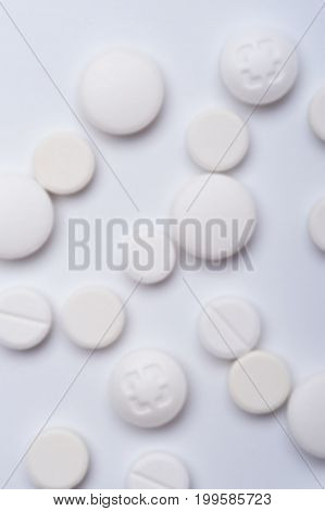 White medicine pills, top view. Medicaments background