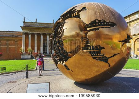 Rome, Italy - July 2016: Close-up details of a metal sphere of the courtyard of the Vatican Museum. Spheres within spheres - a monument in the Cortile della Pigna. Photos from a journey to Rome.