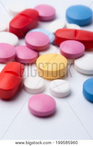 Colorful medicine pills and capsules. Multicolored medicaments, top view.