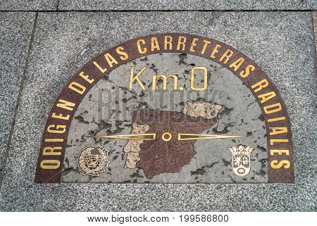 Madrid Spain - May 22 2014: The famous sign plate Km. 0 located on the pavements in Puerta del Sol (Gate of the Sun) a public square and the center of the beginning radial network of Spanish roads.