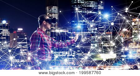 Young man with virtual reality headset or 3d glasses among connection lines