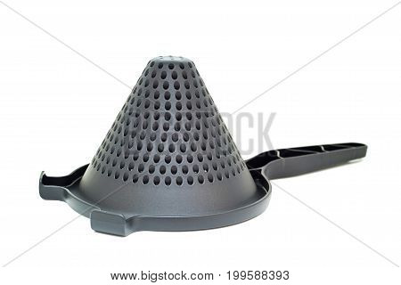 Closeup of black plastic conical utensil with perforation