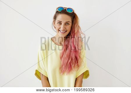 Pretty Young Female With Blue Eyes, Shining Smile And Pink Hair, Having Trendy Sunglasses On Head, D