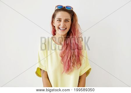 Beautiful Young Woman With Pink Long Hair, Appealing Blue Eyes And Healthy Skin, Wearing Yellow Casu