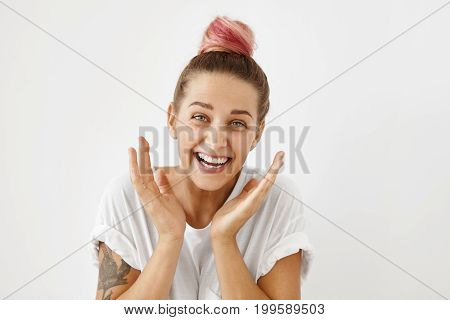 Funny Woman With Hair Bun Raising Her Hands With Joy, Being Glad To See Her Realtives After Long Tim