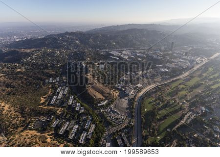 Aerial view towards Barham Blvd, the Los Angeles River, Toluca Lake and Universal City on the edge of the San Fernando Valley in Los Angeles, California.