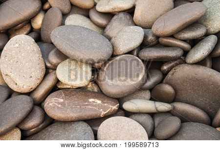Pebbles on the beach close up. .Stones texture