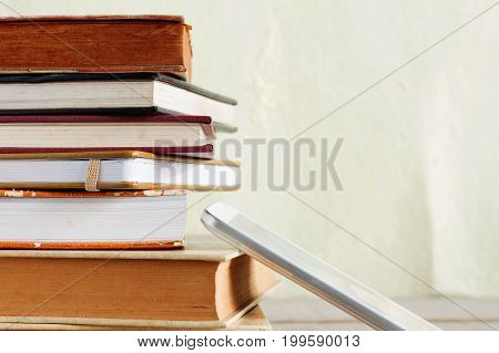 Old Books and tablets on wooden boards.