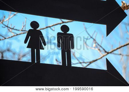 Close up male and female silhouettes showing toilet