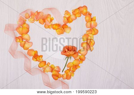 Flowers composition heart symbol made of dried flowers and leaves top view flat lay. Heart of rose petals