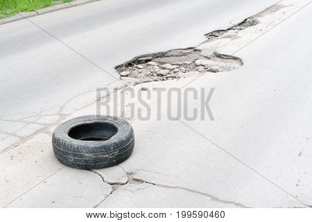 the amtomobilny tire protecting a hole on the road Russia