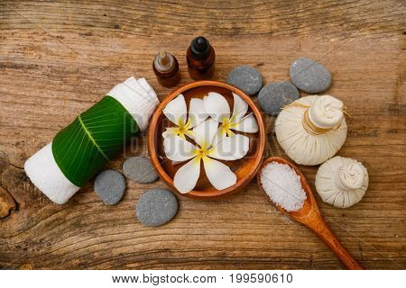 Spa treatment with salt in spoon ,ball ,towel,on old wooden background