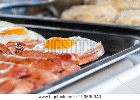 Fried Eggs And Fried Sausages On A Counter In Street Cafe