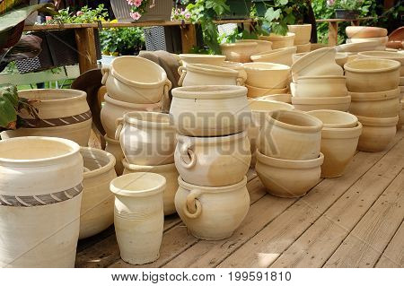 Clay pots for planting flowers and plants in the garden