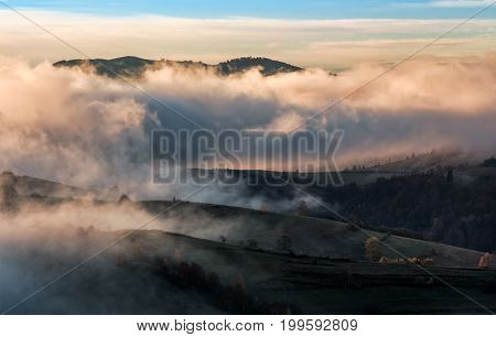 Clouds And Fog Rising Over Countryside