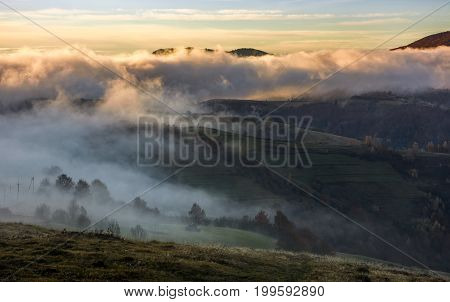 Fog Rising Over The Rural Hills At Dawn