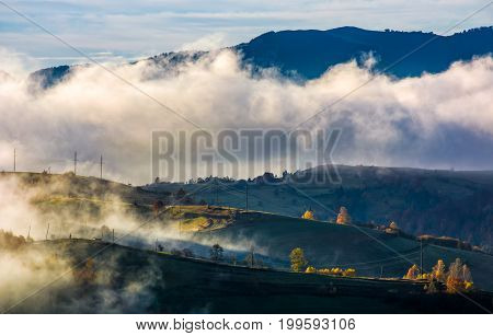 Fog Rising Over The Rural Hills In Morning Light