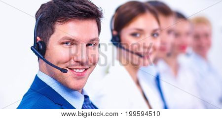 Attractive Smiling positive young businesspeople and colleagues in a call center office