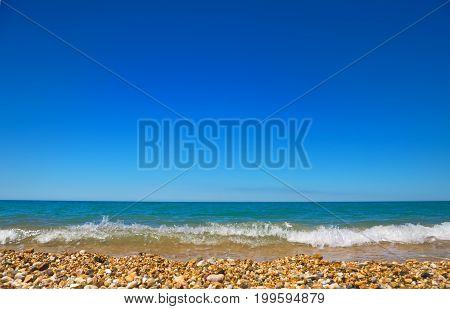 summer sea pebble beach in a Sunny day