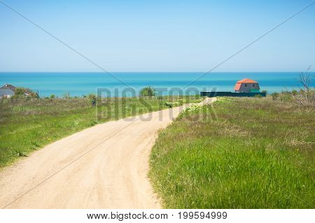 house by the sea on a green hill