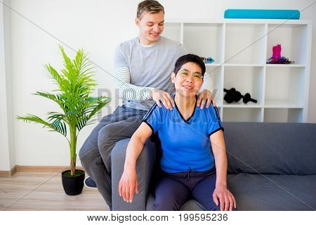 Physiotherapist working with patient in a clinic