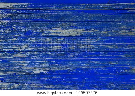 Background of blue weathered peeling wooden boards